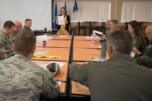 Tiffany Hendershot, a clinical social worker for Berkeley County, W.Va. schools and an aircraft maintenance non-destructive inspection technician for the 167th Airlift Wing, discusses the impact opioid use is having on students in Martinsburg, W.Va., during a lunch and learn event at the Wing, May 30. Hendershot urged participants to get involved with the local schools, volunteer and mentor students.  (U.S. Air National Guard photo by Senior Master Sgt. Emily Beightol-Deyerle)