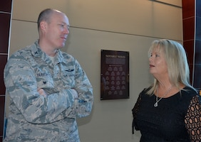Col. Christopher Jarratt, 1st Air Force (Air Forces Northern) Chief of Staff, talks with Carol Roberts, President, Bay County Chamber of Commerce, during the BCCC's First Friday event June 8 at the Holley Center on the Florida State University –Panama City campus. The BCCC event is held the first available Friday each month to offer the opportunity for local business, civic and government officials to meet, network and talk about current issues in the community.  (Photo by Mary McHale)