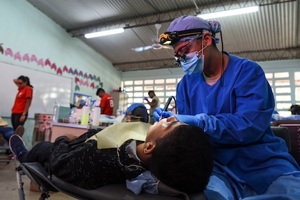 An Air Force dentist treats a patient.