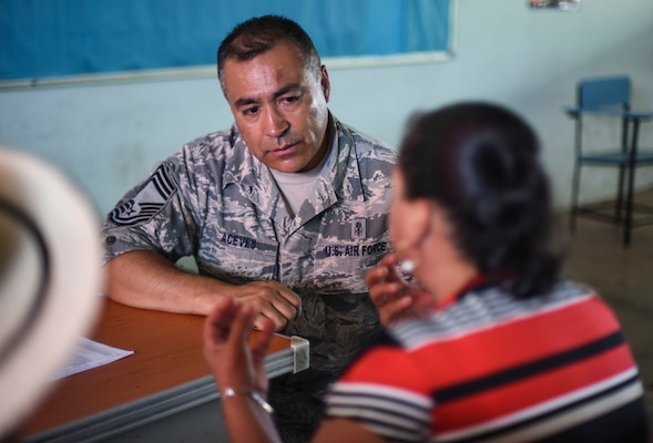 A U.S. Air Force officer speaks with a woman