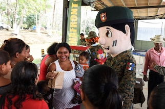 Mascots for the Panamanian National Border Service, known as SENAFRONT, greet guests