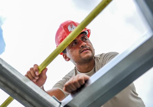 An Air Force engineer assembles a roof