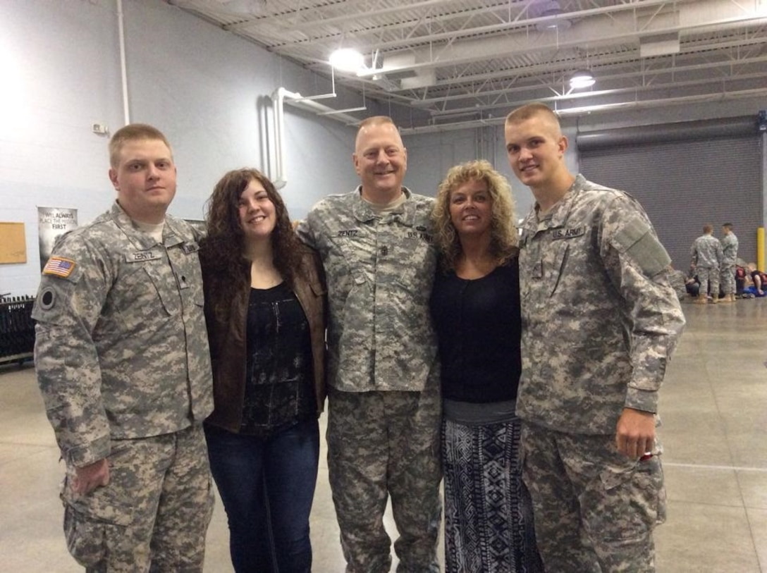 A military family poses for a photo.