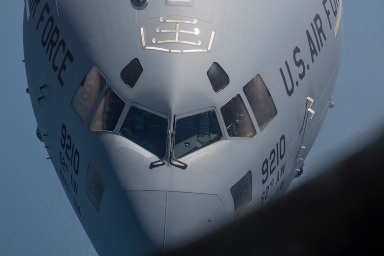 A C-17 Globemaster III aircraft assigned to the 62nd Airlift Wing from Joint Base Lewis-McChord, Wash., prepares to receive fuel over Canada, during Exercise Swift Response 18 (SR18), June 8, 2018.