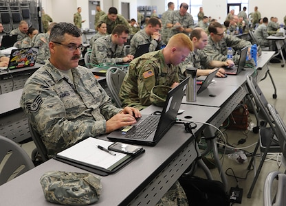 Soldiers and Airmen training with the Cyber Yankee 2018 exercise prepare counter cyber-attacks to scenarios given them during the exercise at Joint Base Cape Cod, Mass.