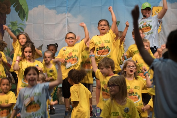 Children and volunteers sing and dance at a Vacation Bible School finale event, June 8, 2018, at Moody Air Force Base, Ga. VBS is designed to assist children in building resiliency to the stressors many military families face. More than 95 children and 65 volunteers attended this year's VBS. (U.S. Air Force photo by Senior Airman Daniel Snider)