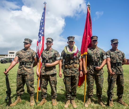 U.S. Marine Corps Lt. Col. Bolivar Pluas and U.S. Marines with the Combat Logistics Battalion 3 (CLB-3) colorguard pose for a photo following a change of command ceremony, Marine Corps Base Hawaii, June 8, 2018. Pluas relinquished command of CLB-3 to Lt. Col. Paul Goguen. (U.S. Marine Corps photo by Lance Cpl. Matthew Kirk)