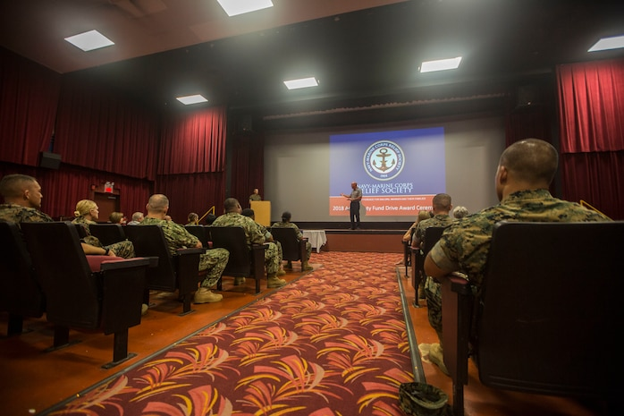 Douglas Wadsworth, chief of staff, Marine Corps Base Hawaii (MCBH), speaks to service members and families during the Navy-Marine Corps Relief Society (NMCRS) Active Duty Fund Drive award ceremony, at the base theater, Marine Corps Base Hawaii, June 11, 2018. The NMCRS provides financial relief to active duty and retired Marines and Sailors as well as their eligible surviving family members through interest-free loans and grants. (U.S. Marine Corps photo by Lance Cpl. Matthew Kirk)