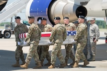 Army carry team transfer remains of Army Staff Sgt. Alexander W. Conrad.