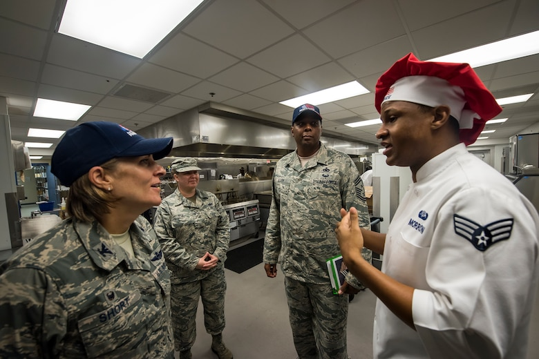 Senior Airman Cameron Morrow, right, 23d Force Support Squadron food service shift leader, briefs Col. Jennifer Short, 23d Wing (WG) commander, during an immersion tour, June 11, 2018, at Moody Air Force Base, Ga. Short and Chief Master Sgt James Allen, 23d WG command chief, toured the Georgia Pines Dining Facility and the Information Learning Center to gain a better understanding of their overall mission, capabilities, and comprehensive duties. (U.S. Air Force photo by Airman 1st Class Eugene Oliver)