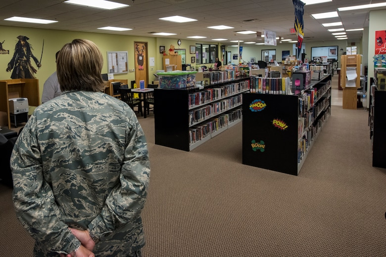 Col. Jennifer Short, 23d Wing (WG) commander, looks inside the library of the Information Learning Center (ILC) during an immersion tour, June 11, 2018, at Moody Air Force Base, Ga. Short and Chief Master Sgt James Allen, 23d WG command chief, toured the Georgia Pines Dining Facility and the ILC to gain a better understanding of their overall mission, capabilities and comprehensive duties. (U.S. Air Force photo by Airman 1st Class Eugene Oliver)