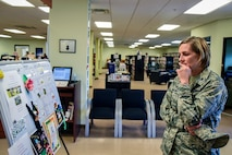 Col. Jennifer Short, 23d Wing (WG) commander, reads the schedule for the library of the Information Learning Center during an immersion tour, June 11, 2018, at Moody Air Force Base, Ga. Short and Chief Master Sgt James Allen, 23d WG command chief, toured the Georgia Pines Dining Facility and the ILC to gain a better understanding of their overall mission, capabilities and comprehensive duties. (U.S. Air Force photo by Airman 1st Class Eugene Oliver)