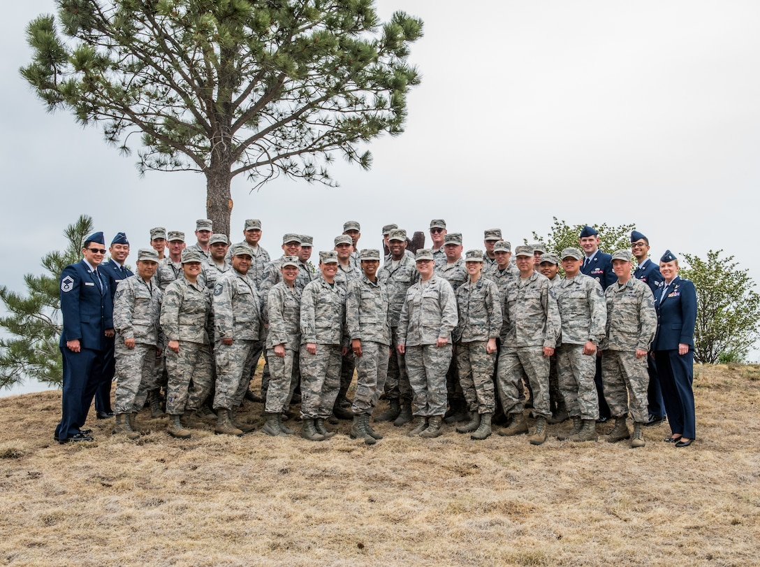 Members of the 19th Space Operations Squadron pose for a group photo with outgoing commander, Lt. Col. Karen Slocum, before the 19 SOPS Change of Command, June 3, 2018.