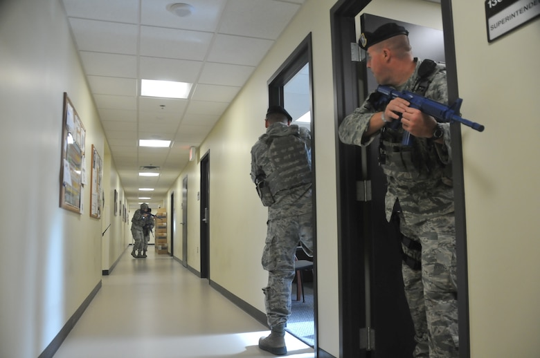 Security Forces Airmen with the 128th Air Refueling Wing, Wisconsin Air National Guard, clear a building after a simulated active shooter exercise Aug. 13, 2017.