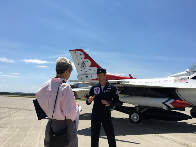 Maj. Branden Felker, advance pilot and narrator for the U.S. Air Force Thunderbirds, interviews with media June 12 on Westover's flightline.  This will be the first time in 10 years that the Air Force's official aerial demonstration team has performed at Westover.