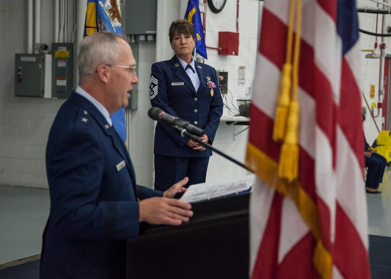 U.S. Air Force Brig. Gen. Gary Ebben speaks after presenting Command Chief Master Sgt. Connie Back with the Legion of Merit Award during a change of authority ceremony at the 128th Air Refueling Wing, Wisconsin Air National Guard, Oct. 14, 2017.