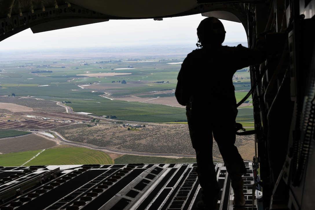 Airman 1st Class Samantha Martino, 7th Airlift Squadron loadmaster, prepares to drop a container delivery system bundle out of a C-17 Globemaster III onto the Rainier Drop Zone near Moses Lake, Wash., June 6, 2018. Martino was participating in Exercise Rainier War, which provided insights on how to better execute a tactical scenario for possible future conflicts. (U.S. Air Force photo by Senior Airman Tryphena Mayhugh)