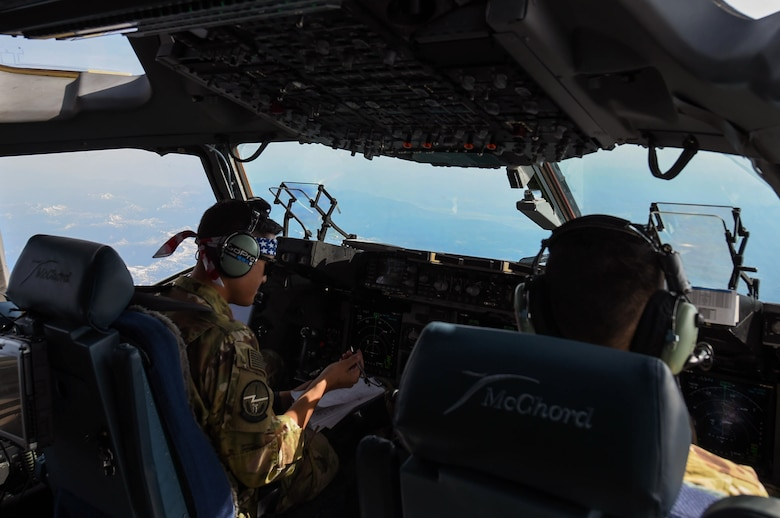 Capt. Tate Montgomery, 7th Airlift Squadron pilot, flies a C-17 Globemaster III near Moses Lake, Wash., June 6, 2018. Montgomery was participating in Exercise Rainier War, which provided insights on how to better execute a tactical scenario for possible future conflicts. (U.S. Air Force photo by Senior Airman Tryphena Mayhugh)