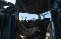 Capt. Tate Montgomery, 7th Airlift Squadron pilot, flies a C-17 Globemaster III towards a KC-135 Stratotanker for refueling during Exercise Rainer War near Moses Lake, Wash., June 6, 2018. Three KC-135 Stratotankers participated in Exercise Rainier War to provide in-air refueling to the multiple C-17s executing tactical combat missions. (U.S. Air Force photo by Senior Airman Tryphena Mayhugh)