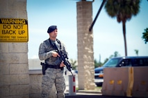 U.S. Air Force Airman 1st Class Nicholas McNeely, an installation entry controller assigned to the 6th Security Forces Squadron (SFS), watches over Bayshore Gate at MacDill Air Force Base, Fla., June 12, 2018.