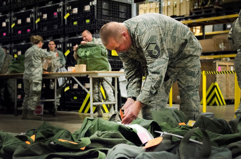 An Airman tags a deployment mobility bag during a generation exercise at the 128th Air Refueling Wing, Wisconsin Air National Guard, Nov. 5, 2017.