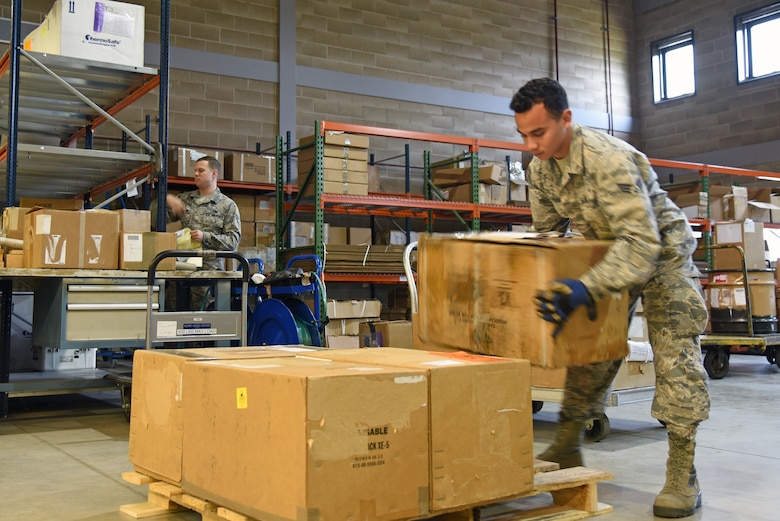 Senior Airman Bruno Iglesia, from the 161st Logistics Readiness Squadron, loads boxes onto a pallet during a two-week training exercise at Royal Air Force Lakenheath, England May 29, 2018. The training exercise allowed members from Arizona Air National Guard an opportunity to work alongside their active-duty counterparts from the 48th Fighter Wing to ensure mission readinesss. (U.S. Air National Guard photo by Staff Sgt. Dillon Davis)