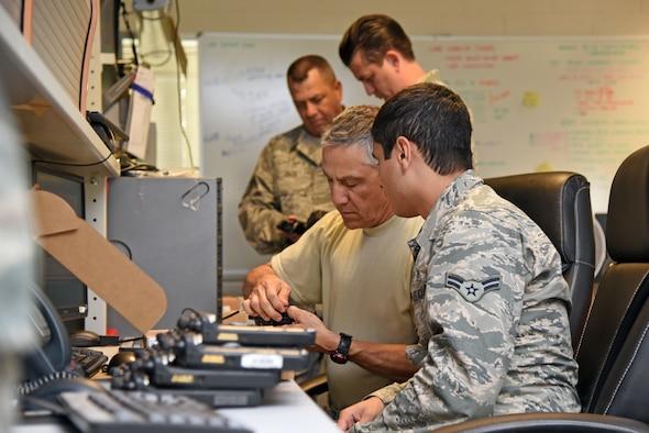 Airmen from the 161st Communications Flight perform inventory and function checks for radio equipment during a two-week training exercise with their counterparts at the 48th Communications Squaron at Royal Air Force Lakenheath, England May 29, 2018. The 161st CF Airmen spent two weeks working at the 48th CS to ensure continue mission readiness and gain valuable insight into the daily operations of an active duty communications squadron. (U.S. Air National Guard photo by Staff Sgt. Dillon Davis)