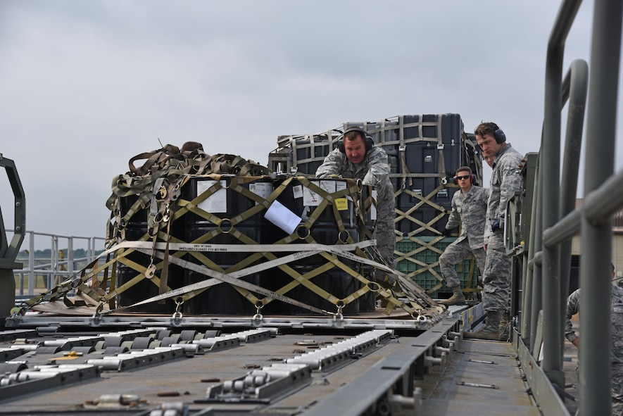 Airmen from the 161st Logistics Readiness Squadron push a palletized load onto a 60K loader during a two-week training exercise at Royal Air Force Lakenheath, England May 29, 2018. The Airmen were able to work alongside their active-duty counterparts at the 48th Logistics Readiness Squadron aerial port to get hands-on experience and training and improve overall mission readiness. (U.S. Air National Guard photo by Staff Sgt. Dillon Davis)