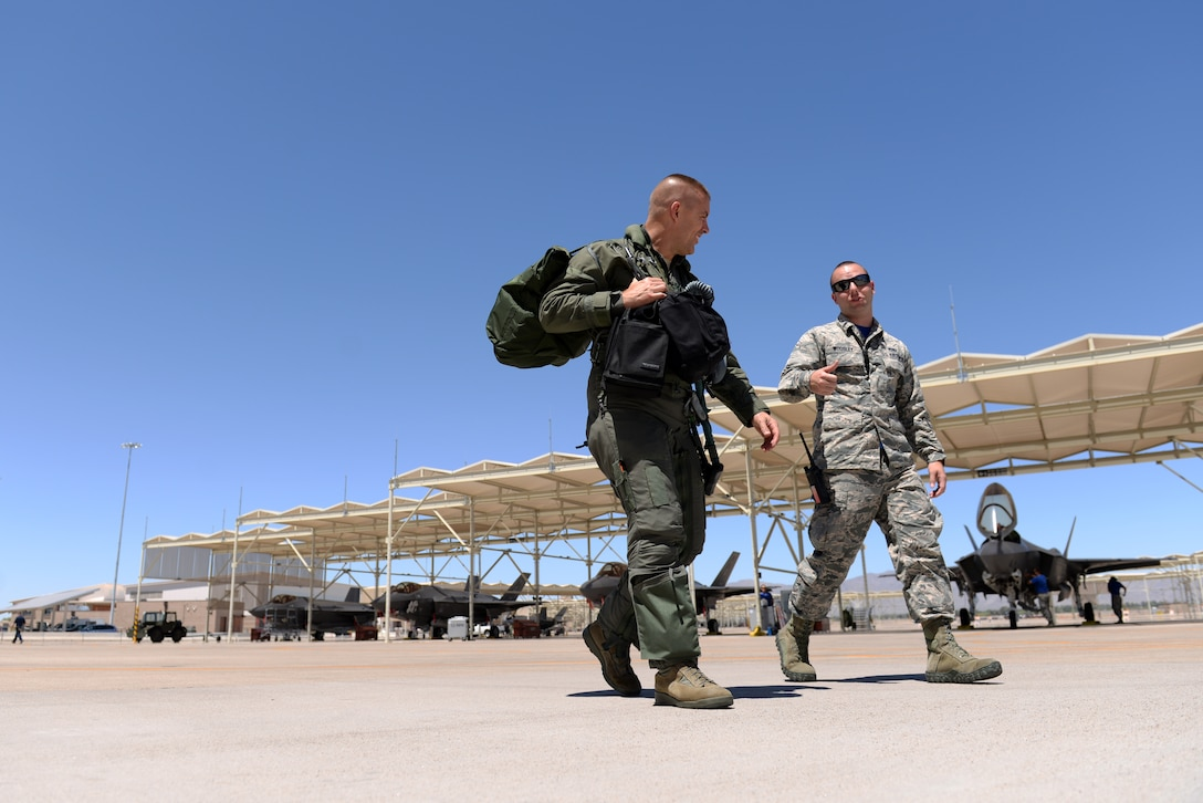 Brig. Gen. Brook Leonard, 56th Fighter Wing commander, steps tohis jet in his final sortie as commander of Luke Air Force Base, Ariz., June 8, 2018. Leonard is an accomplished F-16 and F-35 fighter pilot and completed his F-16 Initial Qualification Course at Luke in 1995. (U.S. Air Force photo by Senior Airman Ridge Shan)