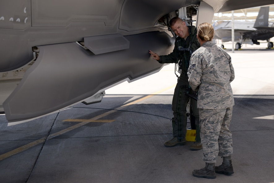 Brig. Gen. Brook Leonard, 56th Fighter Wing commander, inspects his F-35A Lightning II before his final sortie at Luke Air Force Base, Ariz., June 8, 2018. Leonard oversaw the progression of F-35 training and development at Luke through numerous major milestones including the first F-35A Initial Qualification Course graduates. (U.S. Air Force photo by Senior Airman Ridge Shan)