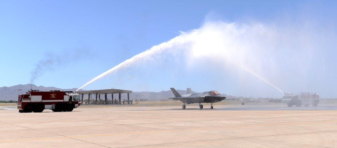 Brig. Gen. Brook Leonard, 56th Fighter Wing commander, taxis his F-35A Lightning II through an arch of water in celebration of his final sortie at Luke Air Force Base, Ariz., June 8, 2018. A commander's final flight at an assignment is an occasion steeped in tradition and celebration. (U.S. Air Force photo by Senior Airman Ridge Shan)