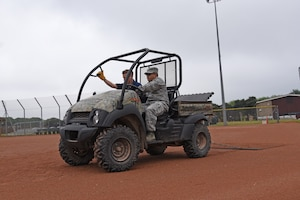 An Airman from the 161st Force Support Squadron, accompannied by his counterpart from the 48th Force Support Squadron, uses a utility vehicle to groom a softball field before an upcoming tournament at Royal Air Force Lakenheath, England May 30, 2018. The Airman worked with multiple section of the 48th FSS to get a variety of valuable training and experience to help improve knowledge and mission readiness. (U.S. Air National Guard photo by Staff Sgt. Dillon Davis)