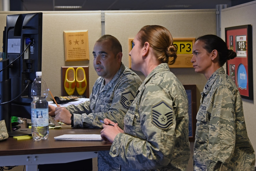 Airmen from the 161st and 48th Comptroller Squadrons work together to complete travel vouchers during a two-week training exercise at Royal Air Force Lakenheath, England May 30, 2018. The Arizona Air National Guard Airmen spent two weeks working alongside Airmen from the 48th CPTS to gain valuable knowledge and improve mission readiness. (U.S. Air National Guard photo by Staff Sgt. Dillon Davis)