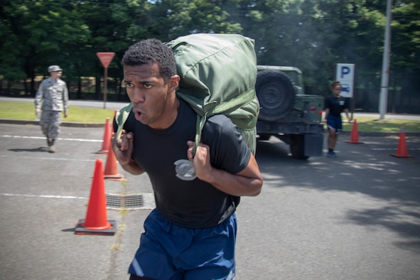 Senior Airman Antonio Gant, 374th Security Forces Squadron armorer, carries his chemical gear bag during an Ability to Survive and Operate (ATSO) Rodeo