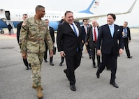 U.S. Secretary of State Mike Pompeo, center, arrives at Osan Air Base, Republic of Korea, June 13, 2018. During his visit, he will meet with senior South Korean and Japanese officials to discuss the U.S.-South Korea alliance, the U.S.-Japan alliance, shared priorities and the next steps in the ongoing, diplomatically-led efforts with the Democratic People's Republic of Korea. (U.S. Air Force photo by Airman 1st Class Ilyana A. Escalona)