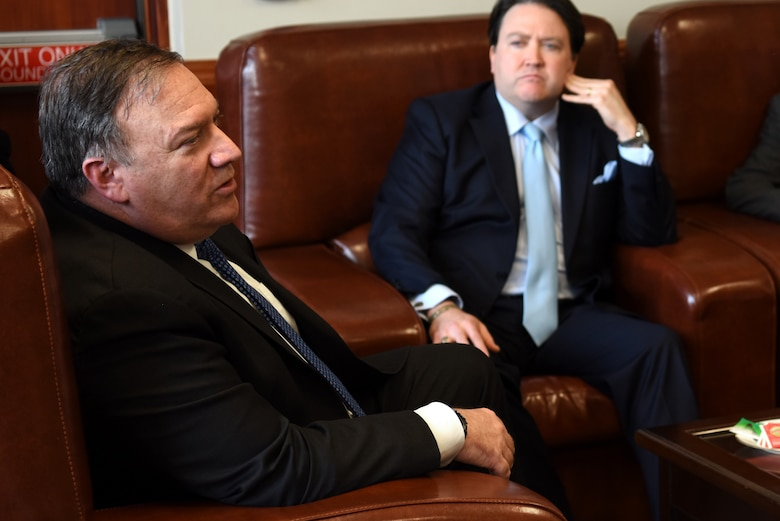 U.S. Secretary of State Mike Pompeo speaks with Marc Knapper, U.S. Embassy in Seoul Charge d'Affaires ad interim, at Osan Air Base, Republic of Korea, June 13, 2018.