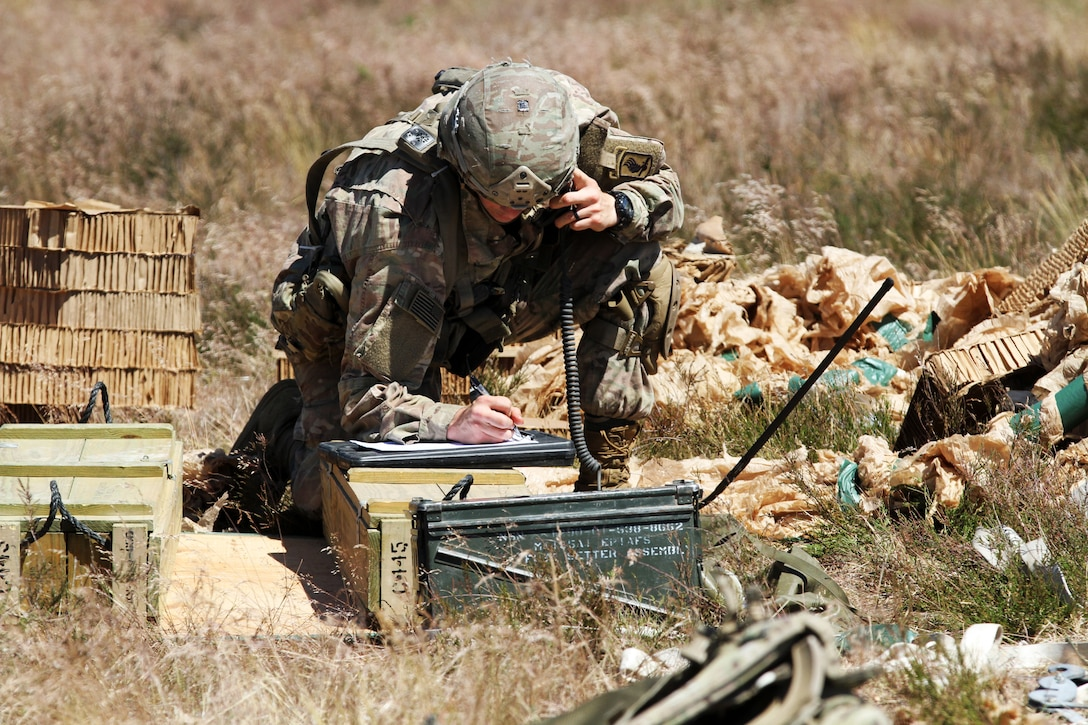 A soldier jots down information during a training event.