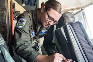 Staff Sgt. Megan Corker, an Airman assigned to the 130th Airlift Wing in West Virginia, records take-off and landing data after her final checkride May 16, 2018, at Little Rock Air Force Base, Ark. Corker performed exceptionally as a student in the 189th Airlift Wing's flight engineer course, graduating ahead of her peers. (U.S. Air National Guard photo by Tech. Sgt. Jessica Condit)