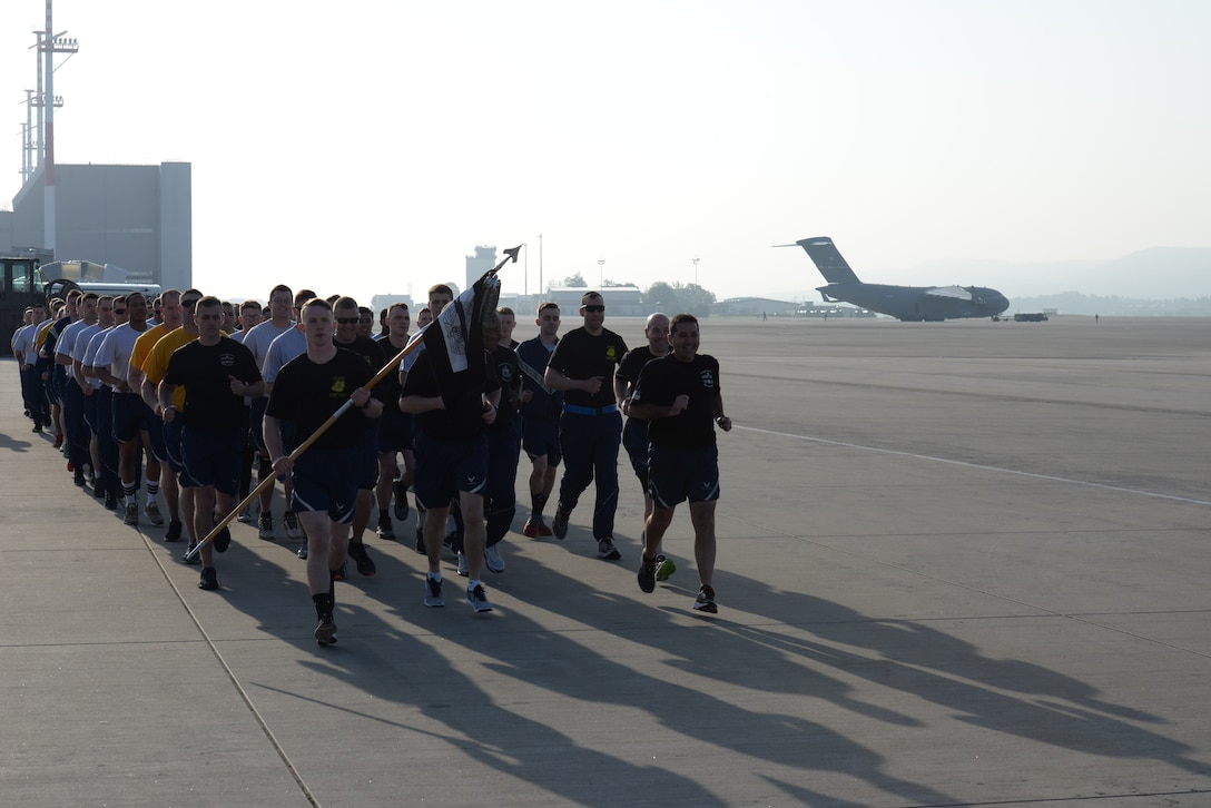 "Each year, the third Friday in May is recognized as National Defense Transportation Day. Members of the Air Force air transportation community, commonly referred to as ""Port Dawgs,"" come together to remember fallen Port Dawgs and the contributions they have given to the Air Force."