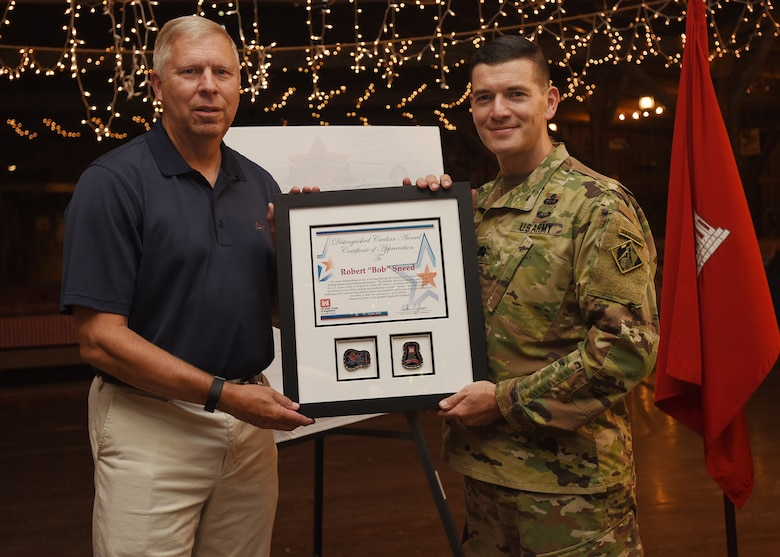 Lt. Col. Cullen Jones (Right), U.S. Army Corps of Engineers Nashville District commander, presents the 2018 Distinguished Civilian Employee Recognition Award to Retiree Bob Sneed, former Water Management Section chief, during an award ceremony June 8, 2018 during the Engineer Day Picnic at Smiley Hollow in Ridgetop, Tenn. Sneed retired in 2016 following 36 years of federal service as a water manager in the Nashville District. (USACE photo by Lee Roberts)