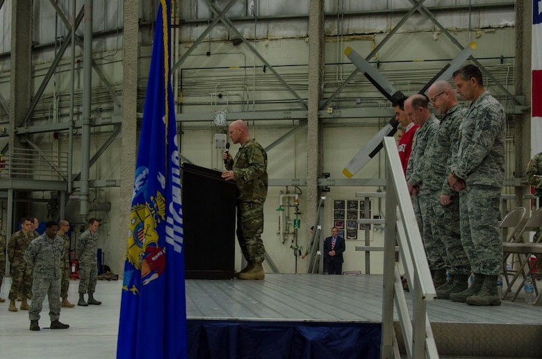 U.S. Air Force Lt. Col. Matthew Friese, wing chaplain of the 128th Air Refueling Wing, Wisconsin Air National Guard, provides the invocation at the beginning of a send-off ceremony at General Mitchell Airfield in Milwaukee, Wisconsin, Dec. 2, 2017.