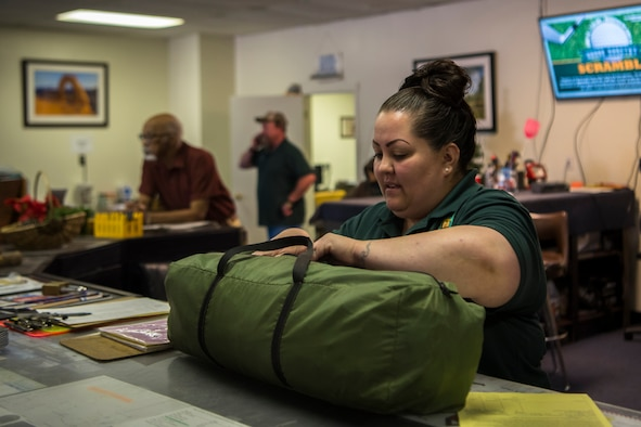 An Outdoor Recreation employee checks the returned camping gear of a customer at Cannon Air Force Base, N.M., July 11, 2018. Employees must check all returned equipment to ensure it comes back in the same condition as it was taken in.