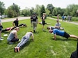 Thomson Reuters employees perform pushups. (Air Force Photo/Paul Zadach)