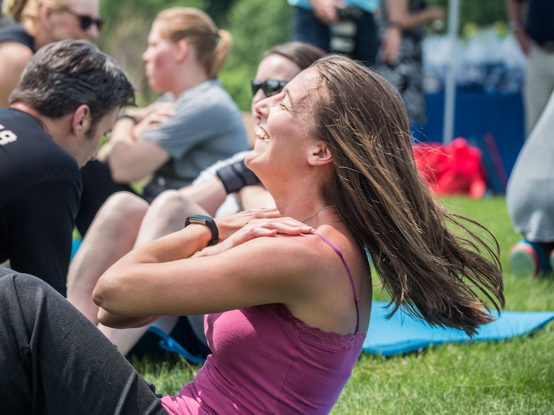 Thomson Reuters employees perform situps. (Air Force Photo/Paul Zadach)