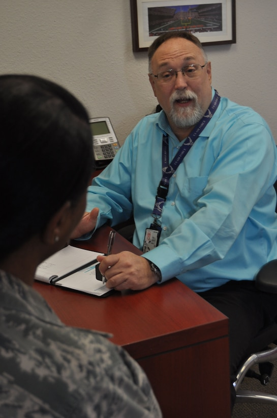 Daniel Pickel, Air Force Reserve Command 433rd Airlift Wing Director of Psychological Health, speaks with an Alamo Wing member in his office at Joint Base San Antonio-Lackland, Texas, Feb. 11, 2018. Pickel provides consultation, training and education, crisis management and therapy to the Reserve Citizen Airmen of the wing. (U.S. Air Force photo by Staff. Sgt. Lauren M. Snyder)