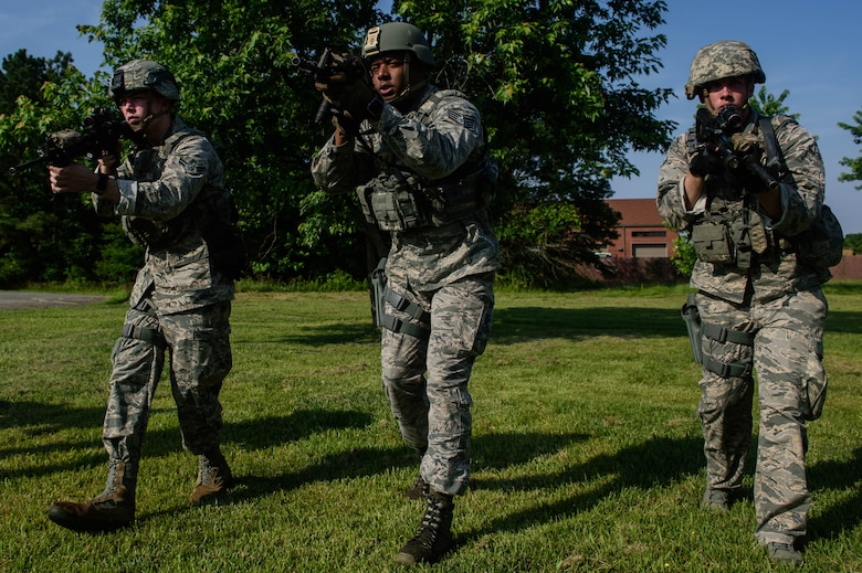 U.S. Air Force Airmen assigned to the 633rd Security Forces Squadron performs muscle memory drills during an emergency services team tryouts at Joint Base Langley-Eustis, Virginia, June 8, 2018. The five first responders learned and practiced squad movement tactics and communication drills to become more effective team members. (U.S. Air Force photo by Senior Airman Derek Seifert)