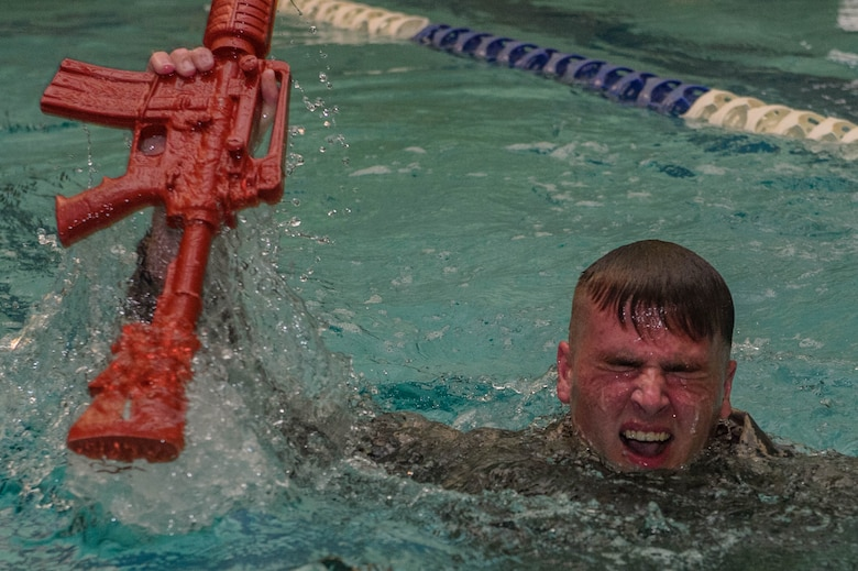 U.S. Air Force Airman 1st Class Colin Matz, 633rd Security Forces Squadron entry controller, recovers equipment during water confidence training during the emergency services team tryouts at Joint Base Langley-Eustis, Virginia, June 8, 2018. The EST mission is to combat any terrorist activity, high risk response or high risk activity. (U.S. Air Force photo by Senior Airman Derek Seifert)