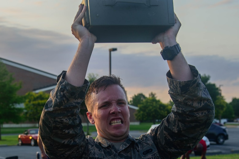 U.S. Air Force Airman Matthew Raymer, 633rd Security Forces Squadron entry controller, performs ammo can presses during the emergency services team tryouts at Joint Base Langley-Eustis, Virginia, June 8, 2018. The tryouts last approximately 24 hours and include water confidence, a fitness obstacle course, a 3-mile ruck march, hand-to-hand combat and other combat drills. (U.S. Air Force photo by Senior Airman Derek Seifert)