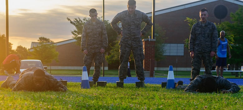 U.S. Air Force Airmen assigned to the 633rd Security Forces Squadron, low crawl during the emergency services team tryouts at Joint Base Langley-Eustis, Virginia, June 8, 2018. The team provides services equal to a civilian police SWAT (Special Weapons and Tactics) Team for the installation. (U.S. Air Force photo by Senior Airman Derek Seifert)