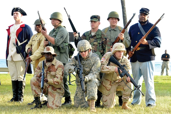 "Soldiers from USARPAC Headquarters Support Company dress in historically accurate uniforms from various periods of Army history for the ""Legacy of Honor"" concert, a free two-night sunset musical performance held at Fort DeRussy during Pacific Theater Army Week, held in celebration of the U.S. Army's 239th birthday."